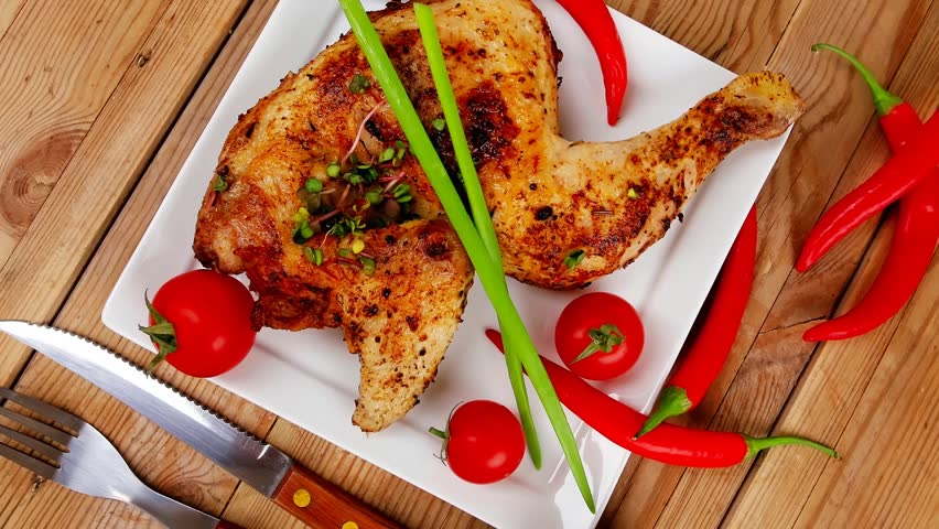 meat food : chicken legs garnished with hot chili peppers plates over wooden table 1920x1080 intro motion slow hidef hd