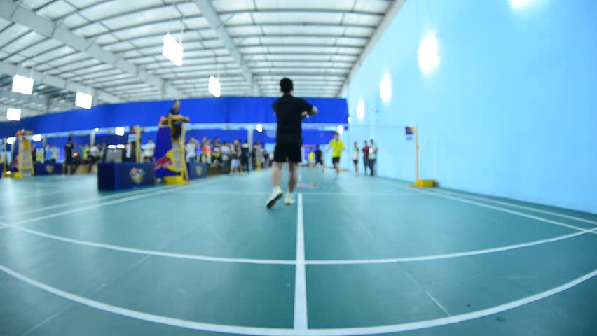 Badminton courts with players competing in indoor hd for Indoor badminton court height