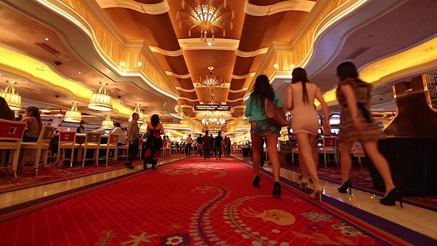LAS VEGAS,NEVADA - CIRCA April 2012 :people walking inside the wynn casino hotel red carpet