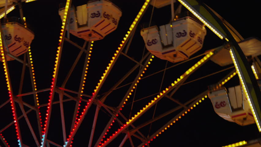 Low angle medium shot of Ferris Wheel at amusement park at night / Salt Lake City, Utah, United States - HD stock video clip