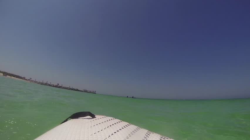 POV Laying down on a paddle board in the ocean - HD stock footage clip