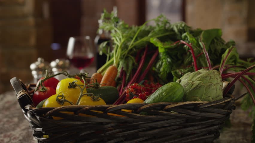 Panning close up of fresh vegetables in basket on kitchen counter  - 4K stock video clip