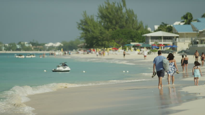 Cayman Islands, Grand Cayman, Seven Mile Beach - April 10, 2012 - People at tropical beach