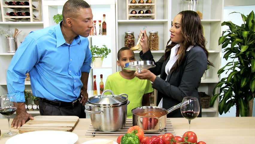 Happy young african american family home dinner young for American family homes