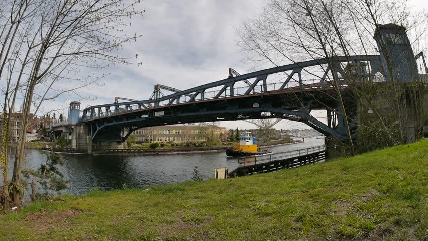 Seattle, Washington - March, 2014 - Slow motion of a boat passing under the Fremont Street drawbridge.