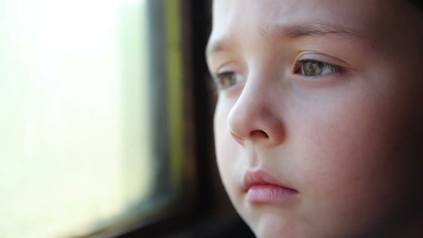 small child is traveling in a train and looks window 3 - HD stock footage clip