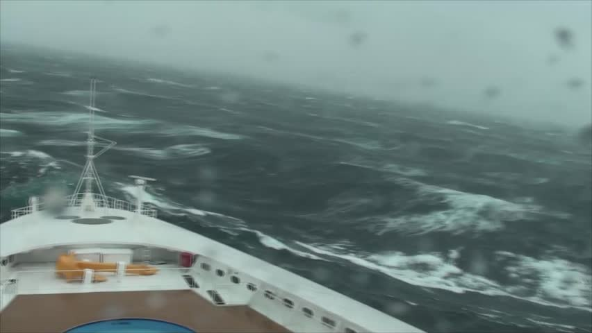 Wave crashes over bow of cruise ship during Force Ten Storm in the Mediterranean.