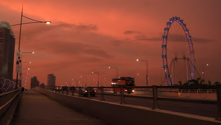 Singapore_21 May, 2014: Singapore Flyer and traffic  at Marina Bay in Singapore at beautiful sunset - HD stock footage clip