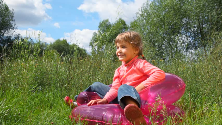 girl on inflatable chair
