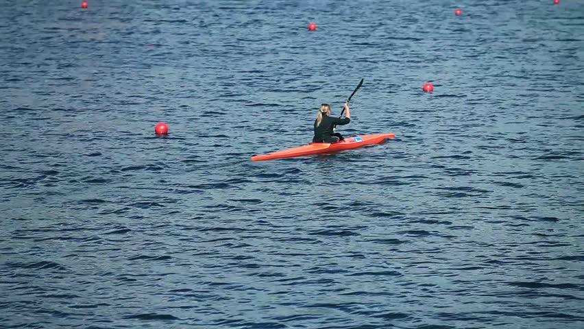 Kayak rowing single woman