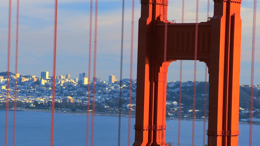 Close-up of cables on Golden Gate Bridge with San Francisco cityscape in background - HD stock footage clip