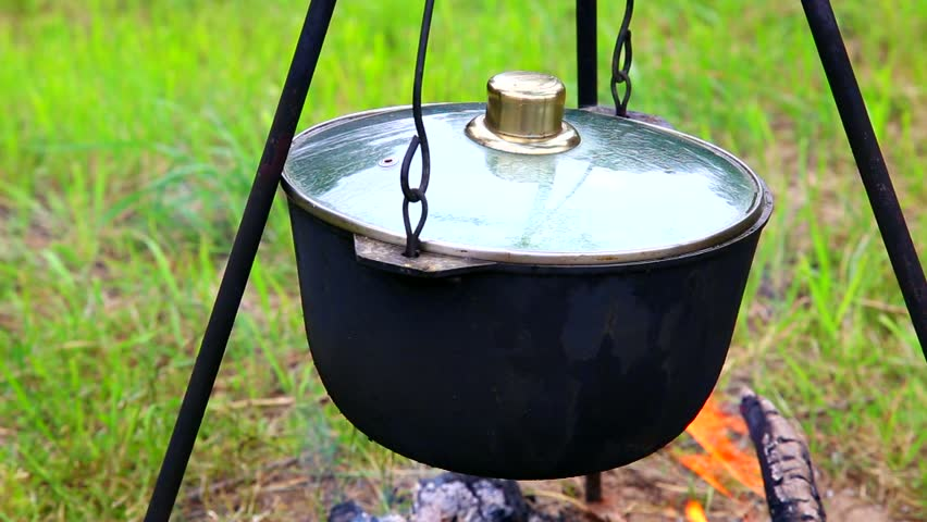 Fish soup in cast iron cauldron on fire stock footage for Iron fish for cooking