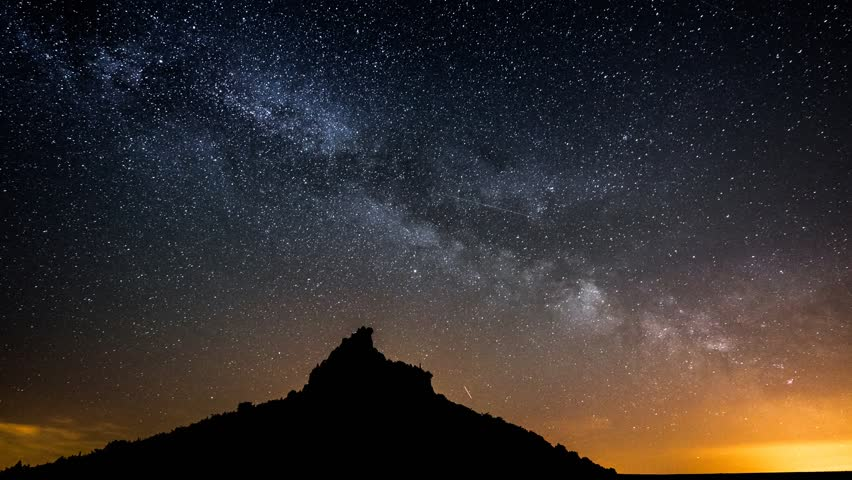 4K UHD milky way over a table mountain - pan tilt shot. 11367