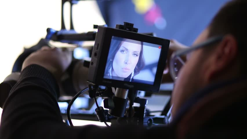 Director looking on camcorder display during shooting singer - HD stock footage clip