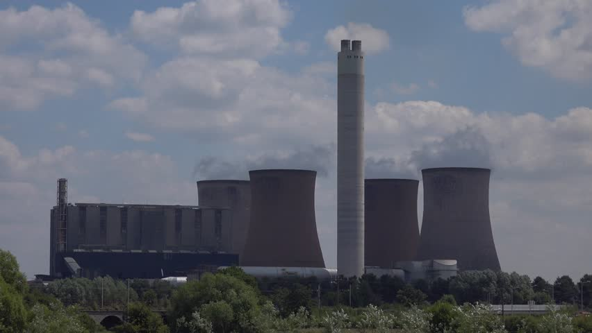 RUGELEY, STAFFORDSHIRE, ENGLAND. JULY 2014:Cooling Towers of Coal Powered Electricity Power Generating Station - 4k ndustrial Buildings Background