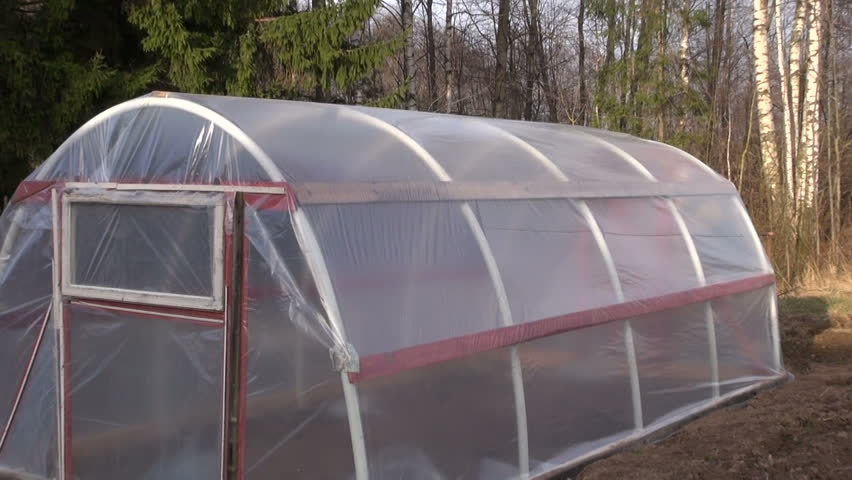 new plastic greenhouse hothouse in spring garden - HD stock footage clip