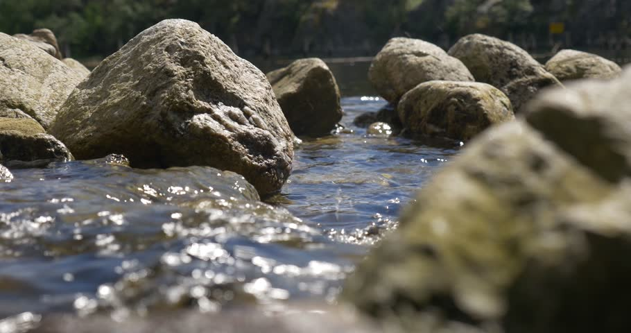 Stream course, rippling water - 4K stock footage clip