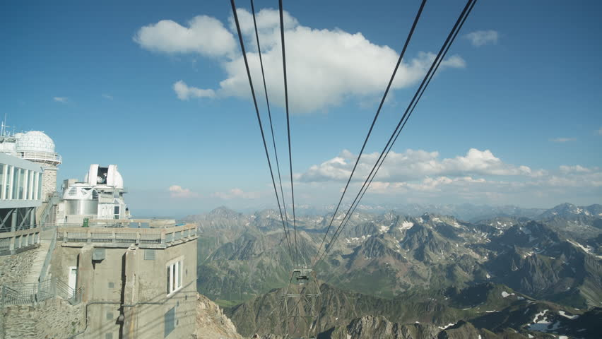 filming in the thrilling cable car ride down from the pic du midi observation station high up in the pyrenees mountains, france