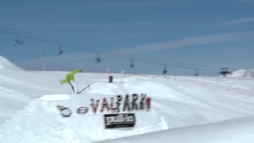 Skier jumps off a ramp, does three and a half spins before landing down
