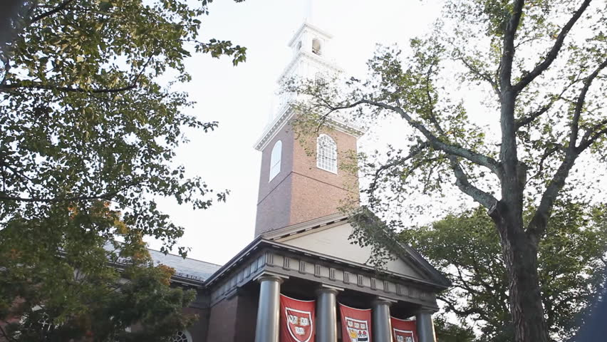 CAMBRIDGE, MASSACHUSETTS - SEPTEMBER 4, 2013: Harvard University  Memorial Church display the Veritas banners displaying the university's arms welcoming new students.