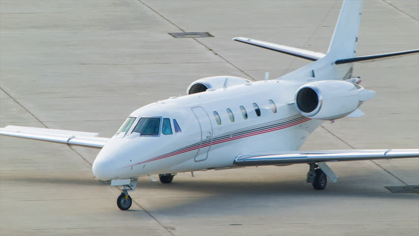 Corporate Jet Arriving at Executive Airport Terminal