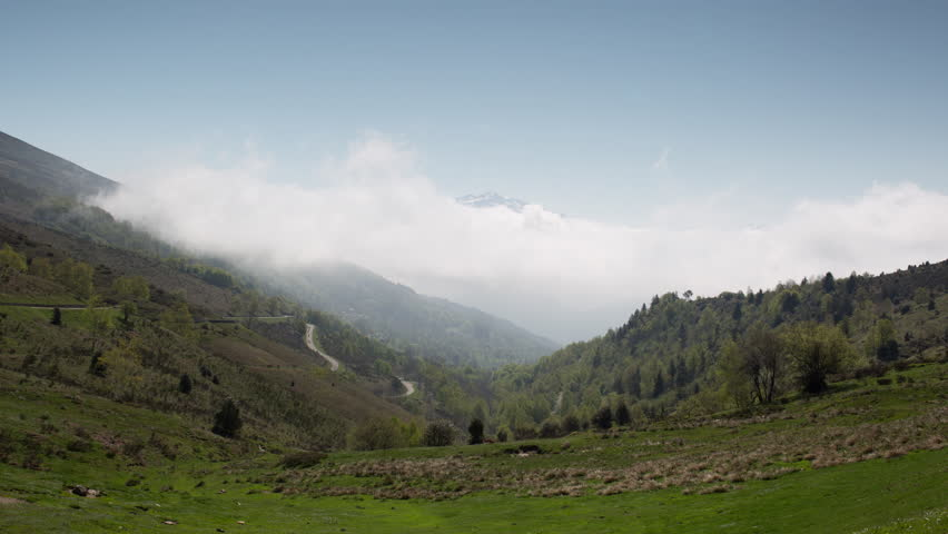 time lapse view from col de port in the french pyrenees. this is a super high quality 4k version at 4096x2304
