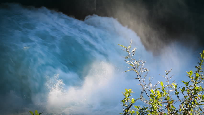 The aqua blue Huka Falls, New Zealand's most visited natural attraction. The Waikato River abruptly narrows and plunges over a hard volcanic ledge, forming spectacular waterfalls and rapids.