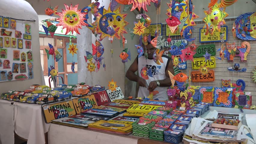 HAVANA, CUBA- JULY 3, 2014: Private market of handcrafted Cuban souvenirs. The Cuban government reforms the economic premises of the system allowing small private production and selling of goods.