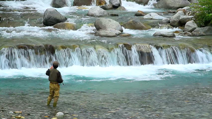 A man fishing on the river.