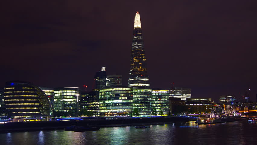 LONDON - Aug 10 2014: London skyline on Thames river with Shard in the background. Completed in 2012, it is the tallest building in the European Union. time lapse view,4k - 4K stock video clip