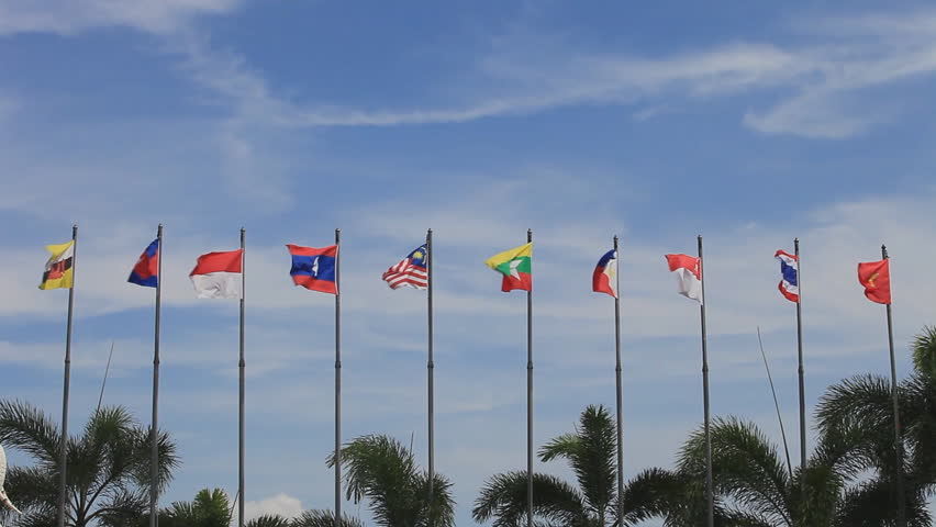 national flags of Southeast asia countries ( ASEAN ) waving atop, blue sky background