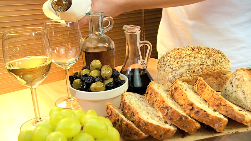 Selection of cheeses, whole-grain bread, oils & fruit with white wine for a healthy modern lifestyle lunch - HD stock video clip