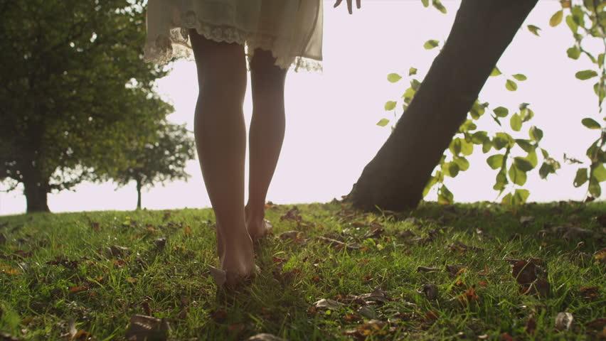 woman walking in grass - photo #36