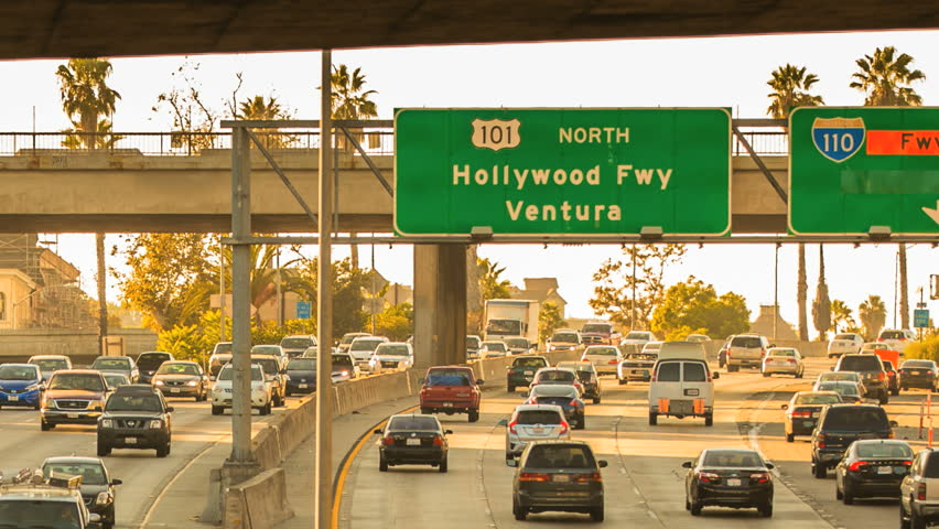 Zoom Out Hollywood Freeway Sign to Sunset Sunrise Timelapse Rush Hour Traffic