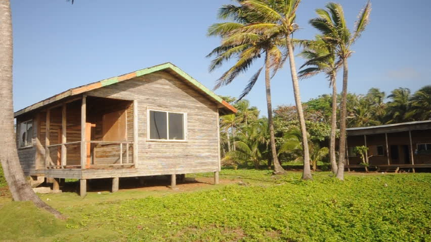 Cabin Big Corn Island Nicaragua with coconut tree panned to fresh water swamp island water supply