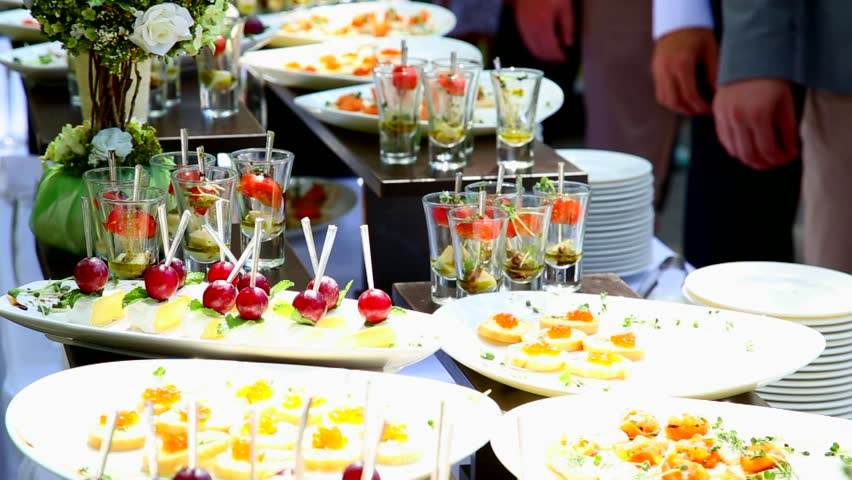 people grab appetizers cocktail party catering buffet catering tables with food stock footage. Black Bedroom Furniture Sets. Home Design Ideas