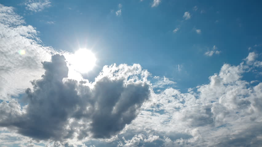 Spectacular sun bursting through clouds beautiful sky timelapse 4K UHD Sun bursts through clouds forming and dissolving across a blue sky.