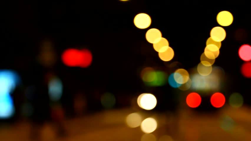 beautiful colorful and bright bokeh lights in the night city, city traffic, abstract; tram