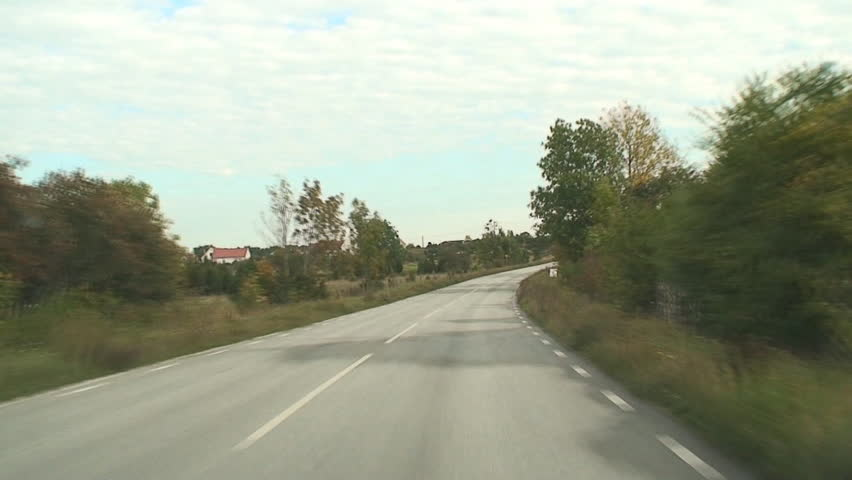 Car driving on a small road in timelapse - HD stock video clip