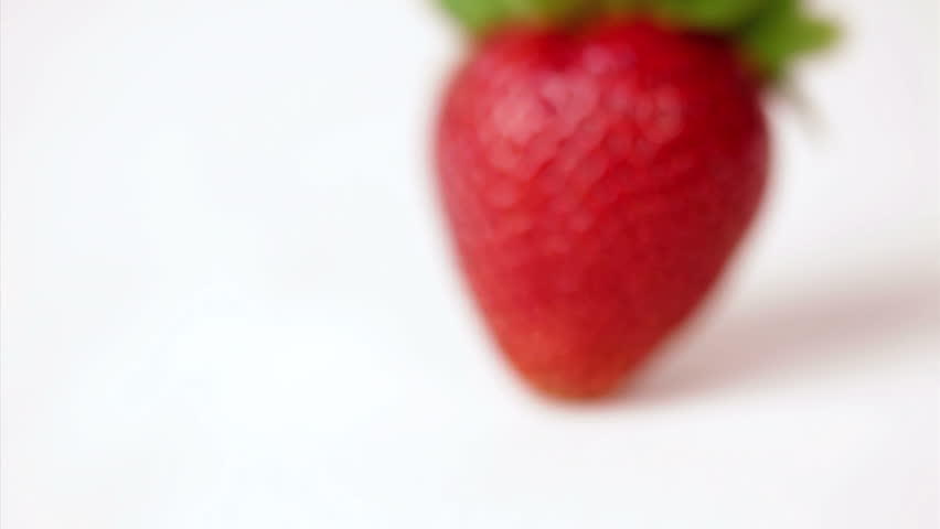 Close up, ripe strawberry, coming into focus, dolly shot - HD stock footage clip