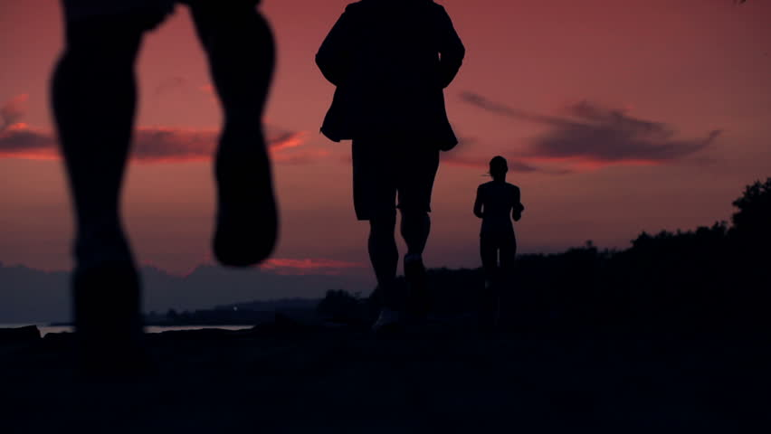 People jogging during beautiful sunset, super slow motion, 240fps
