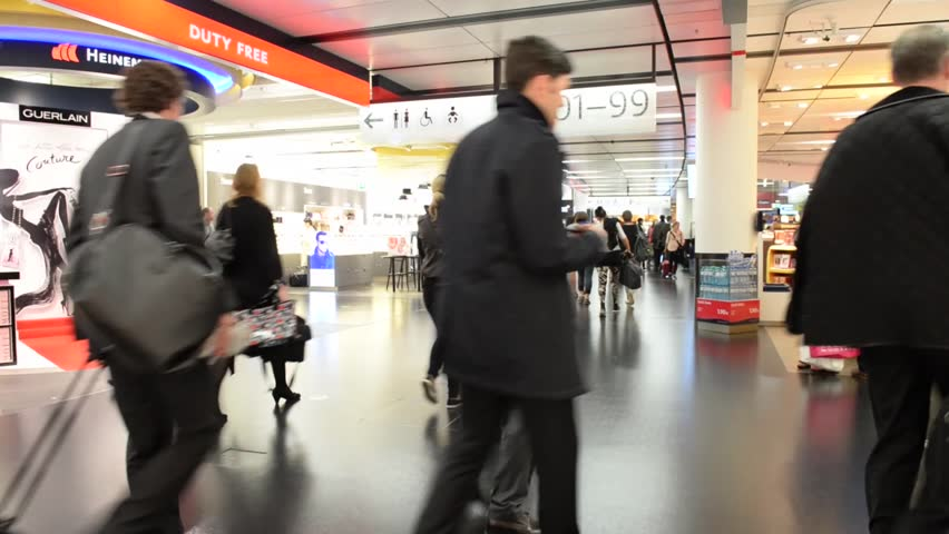 WIEN, AUSTRIA - APRIL 1, 2014: People walking inside Vienna International Airport. It is the country's biggest airport and serves as the hub for Austrian Airlines and its subsidiary Tyrolean Airways.