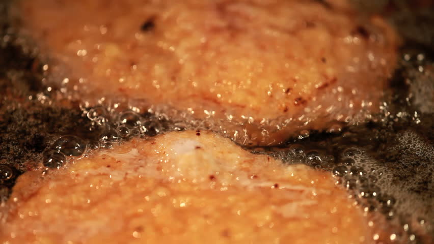 Closeup view on frying meat in skillet  - HD stock video clip