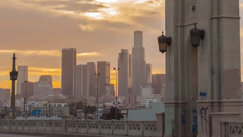 DOWNTOWN, LOS ANGELES, CALIFORNIA, USA - 05 OCTOBER 2014, Red sunset over big city. Timelapse in motion (hyperlapse). Transition from day to night. Spectacular cloudy sky. Close up view on skyscrapers