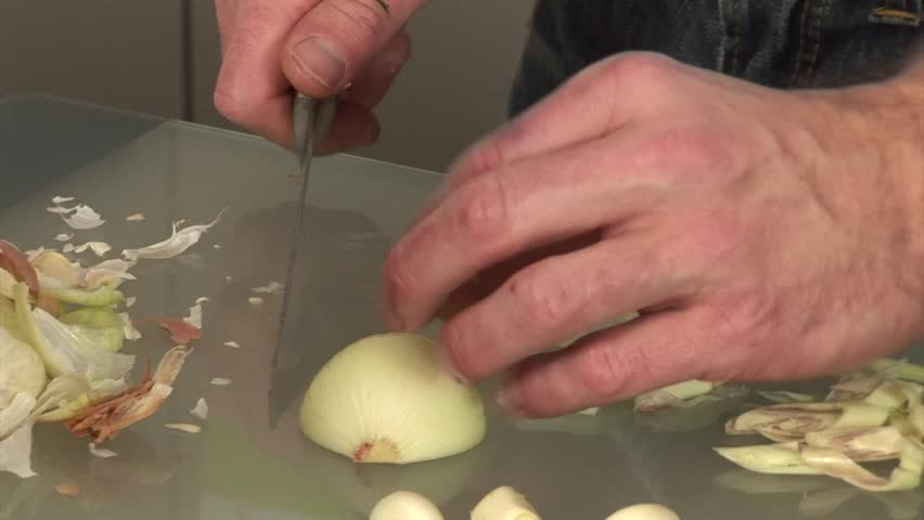 Cook Cutting Onions With Sharp Knife For Vegetables In The