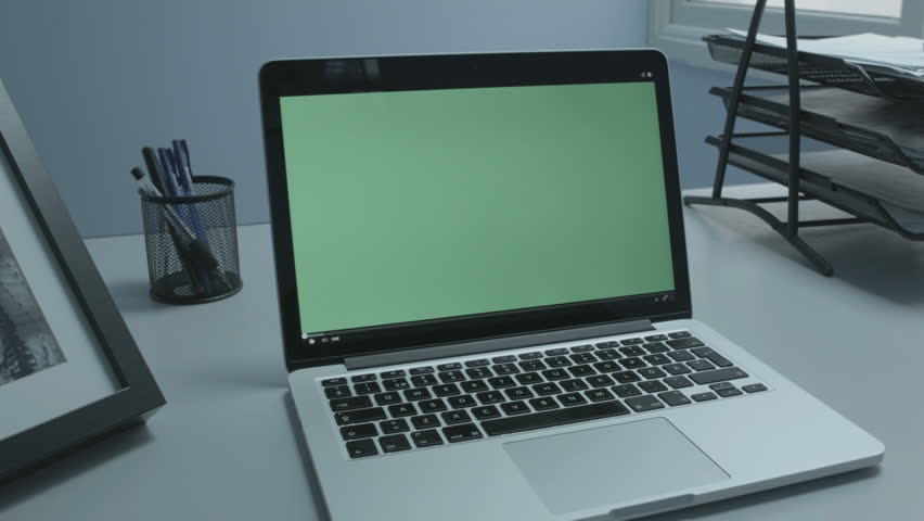 Video player Starts Greenscreen Laptop in office, Side Wide