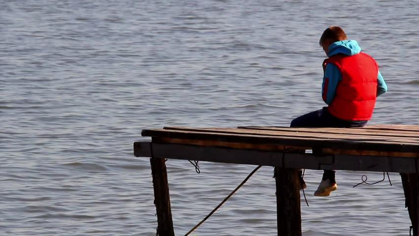 Pier fishing boy stock footage video 7655476 shutterstock for Pier fishing net