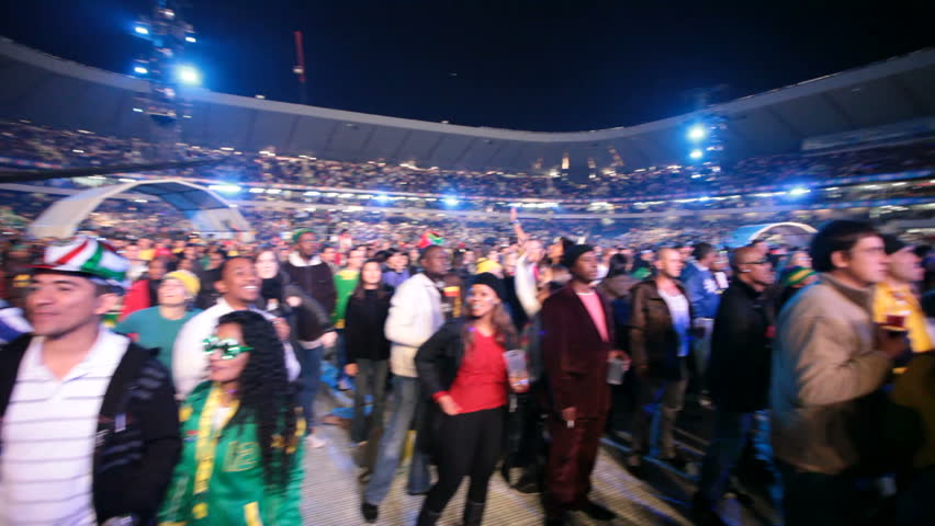 SOWETO - JUNE 10: Fans watches international performers at Orlando Stadium for the FIFA World Cup Kick Off Celebration Concert on June 10, 2010 in Soweto.