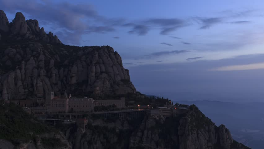 Monastery and Mountain at Montserrat at sunrise, timelapse footage of dark to day transition.