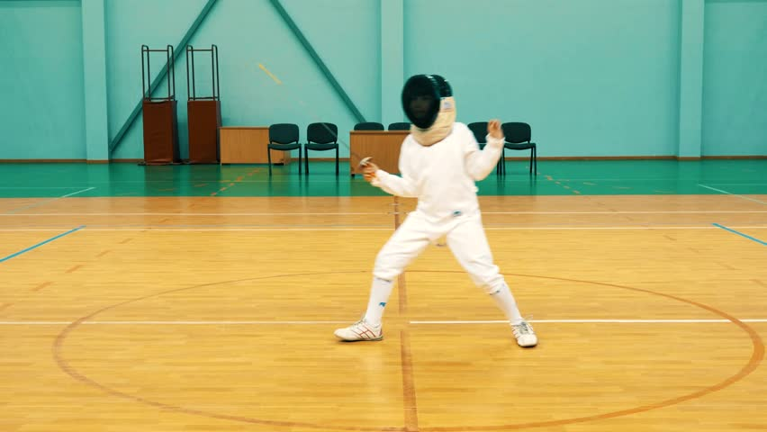 Little girl on a fencing training